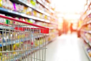 Supermarket interior, empty red shopping cart